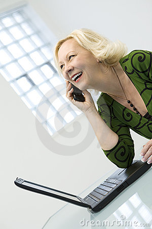 Woman on the phone with laptop