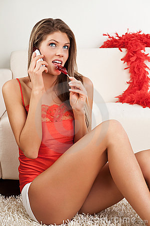 Woman with phone and lollipop