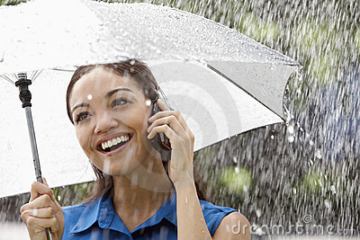 Woman on the phone in the rain