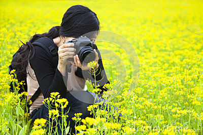 Woman photographer taking pictures in nature