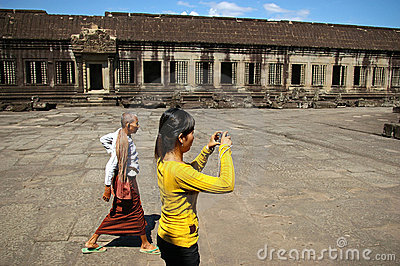 Woman photographing Angkor Wat Editorial Stock Image