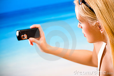 Woman photographing by cell phone