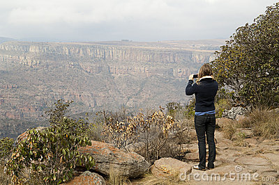Woman photographing mountains
