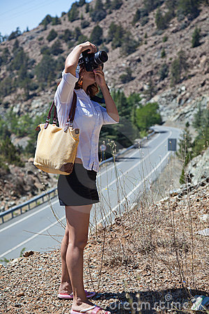 A woman is photographing a nature