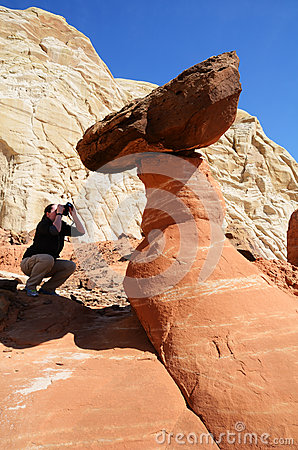 Woman Photographing a Paria Rimrocks Red Toadstool