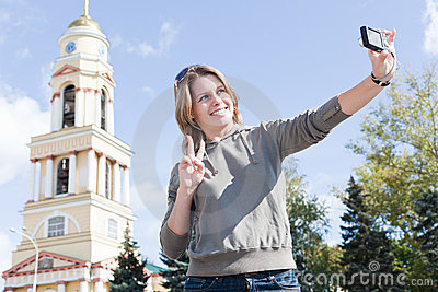 Woman photographing themselves