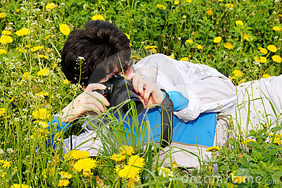 Woman photographs wild flowers