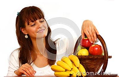 Woman picking fruit (fruits).