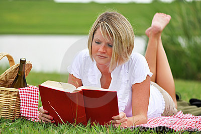 Woman on Picnic with Book and Wine