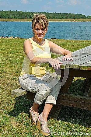 Woman at Picnic Table