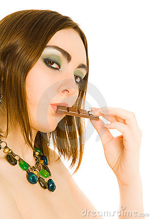 Woman with a piece of choc in her lips