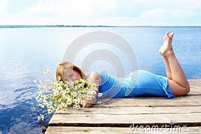 Woman on the pier lake