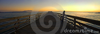 Woman on a Pier During Sunset