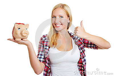 Woman with piggy bank holding thumbs up