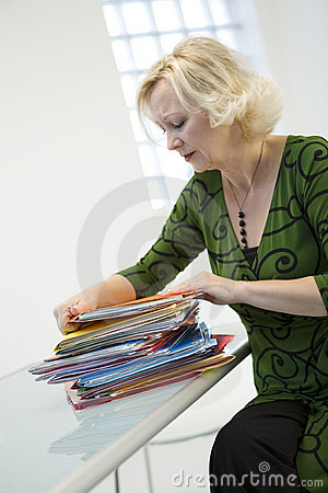 Woman with pile of paperwork