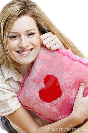 Woman with pillow with heart