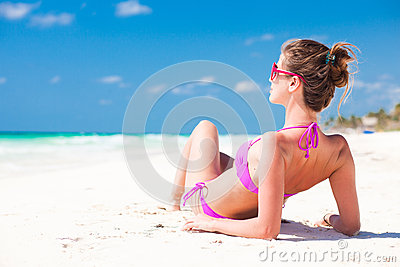 Woman in pink bikini on tropical beach