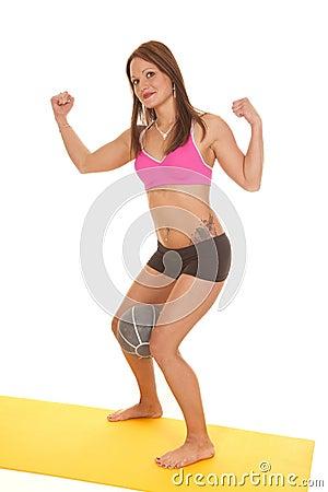 Woman pink bra shorts fitness ball between legs flex