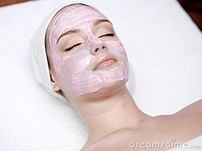 Woman with pink facial mask