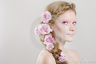 Woman with pink flowers in hair