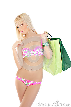 Woman in pink lingerie holding shopping bags