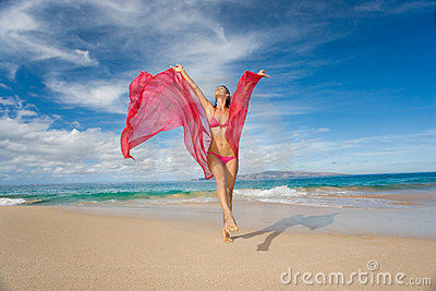 Woman with pink sarong on tropical beach