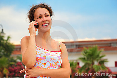 Woman in pink shirt talking on cell phone