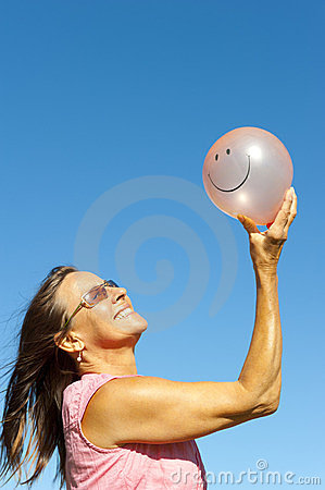 Woman with pink smiley balloon IV