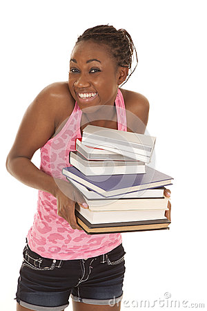Woman pink tank smile hold stack of books