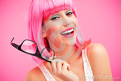 Woman with pink wig and glasses