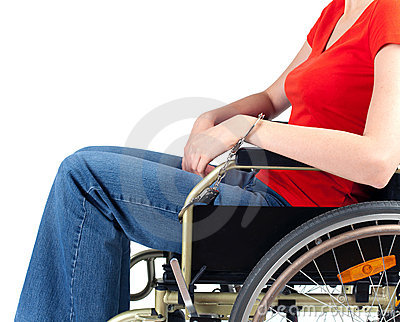 Woman pinned to wheelchair by handcuffs