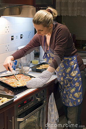 Woman and pizza in kitchen