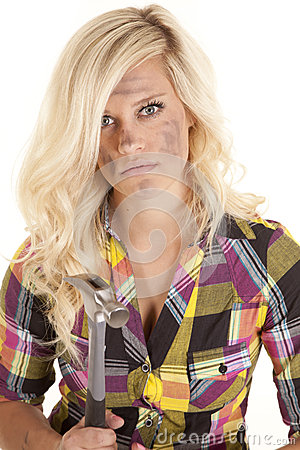 Woman in plaid with hammer