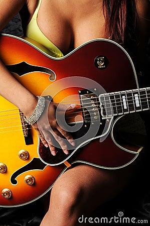 Woman planing guitar