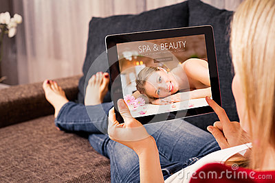 Woman planning spa appointment Stock Photo
