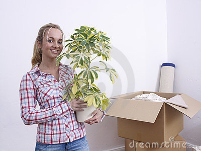Woman with plant and boxes