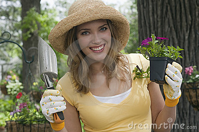 Woman planting flowers in her garden