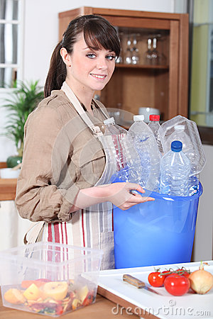 Woman with plastic bottles