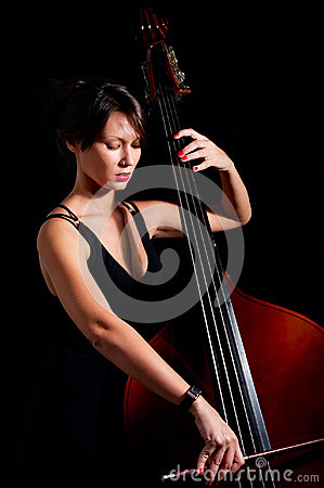 Woman play classic contrabass using