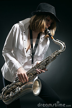 Woman play on saxophone