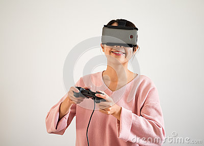 Woman play tv game on joystick and vr device Stock Photo