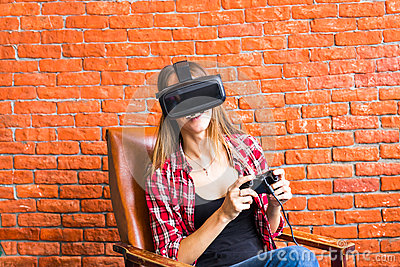 Woman play video game with joystick and VR device Stock Photo