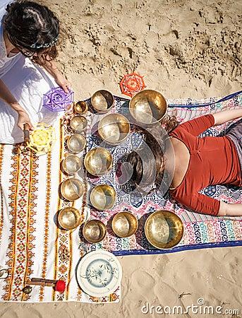 Free Woman Playing A Singing Bowls Also Known As Tibetan Singing Bowls, Himalayan Bowls. Making Sound Massage. Stock Photos - 94963673