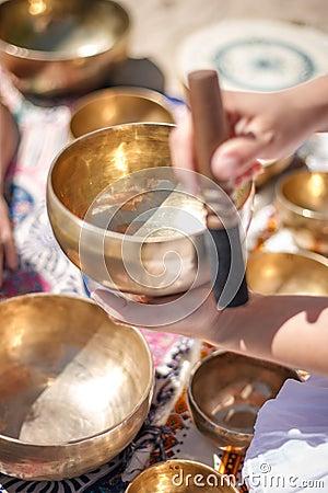 Free Woman Playing A Singing Bowls Also Known As Tibetan Singing Bowls, Himalayan Bowls. Making Sound Massage. Stock Photography - 95199552