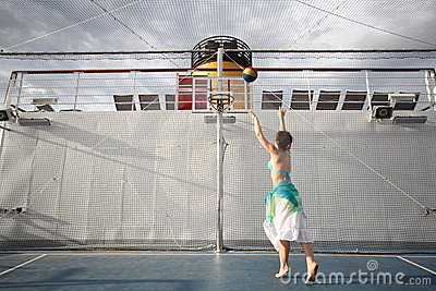 Woman playing basketball on deck of cruise ship