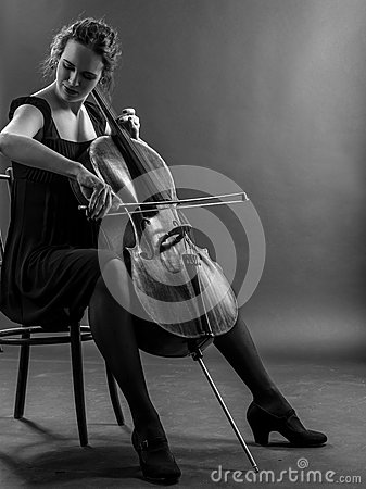 Woman playing the cello black and white