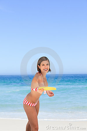 Woman playing frisbee