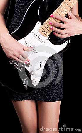 Woman playing on guitar