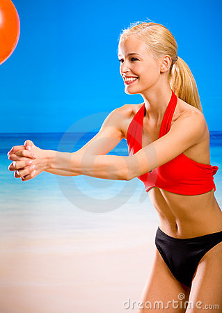 Woman playing with gym ball