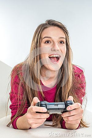 Woman playing with joystick Stock Photo